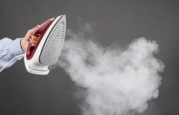 Utiliser un fer à repasser à vapeur